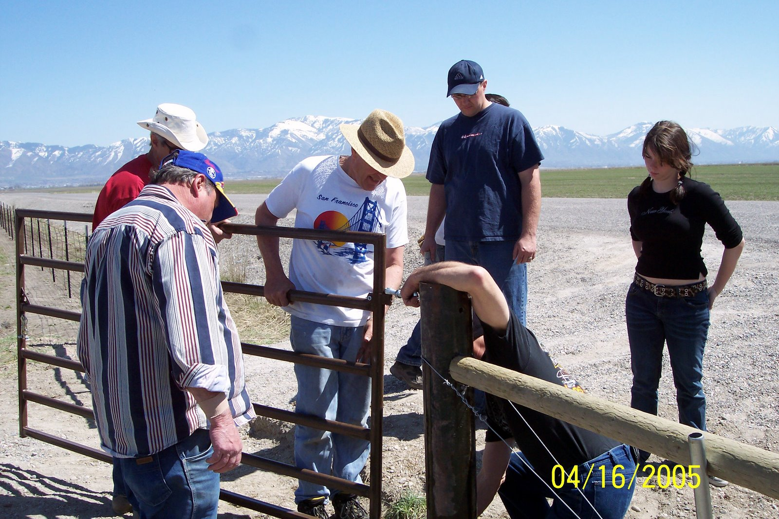 ATTACHING 8 FOOT GATE . IT WAS LATER REPLACED BY A 12 FOOTER.