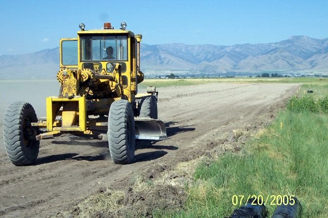 HOOLEY ON THE GRADER. THANKS TO IVAN'S FRIEND FOR LOANING THE USE OF THE GRADER.
