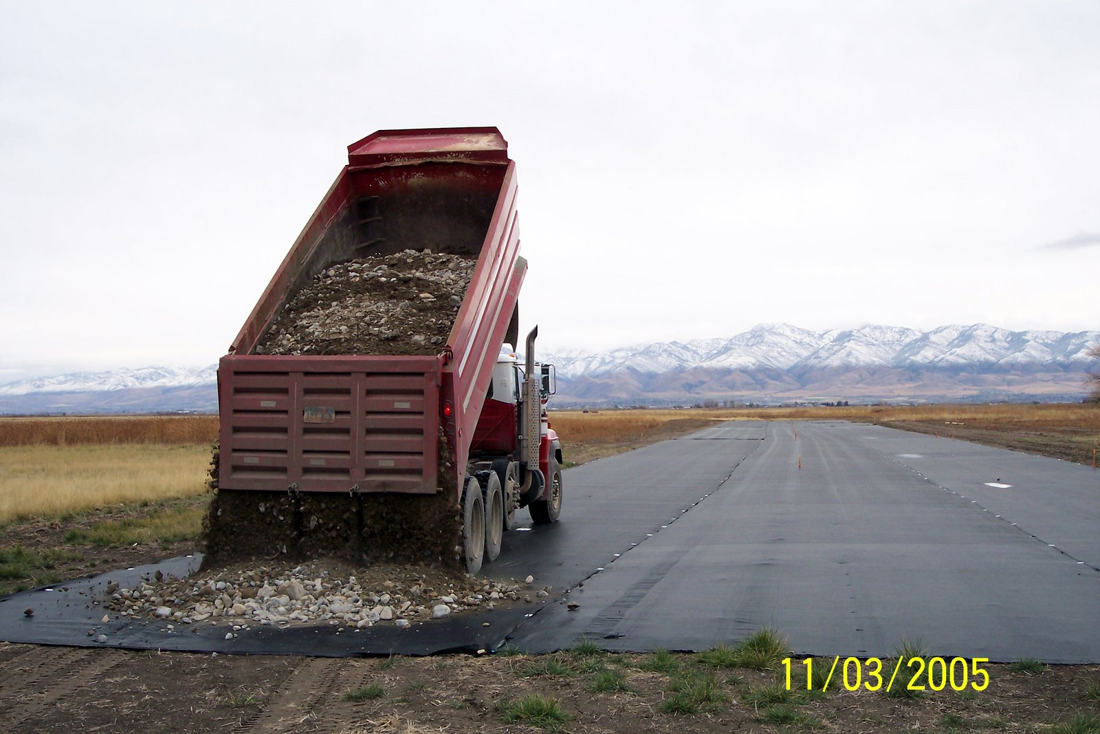 THE FIRST LOAD OF PIT RUN GRAVEL ON THE RUNWAY....A MONUMENTAL MOMENT FOR BRCC.