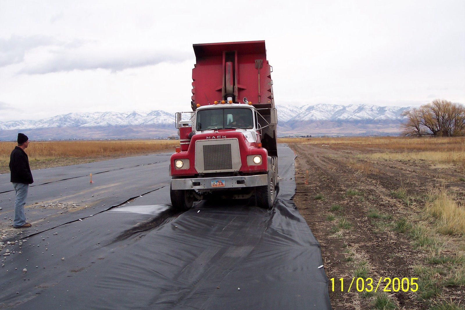 """HOOLEY PONDERS WHEN PLAN """"A"""" IS STALLED AS GRAVEL TRUCK SINKS INTO SOFT SOIL. BEST CREATE A PLAN """"B""""."""