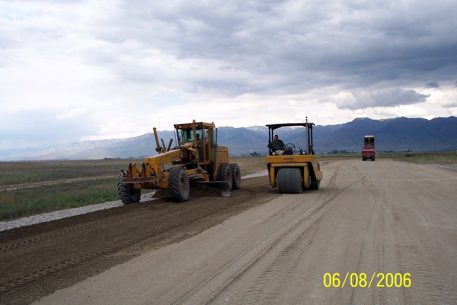 GRADING AND ROLLING ROADBASE GRAVEL.