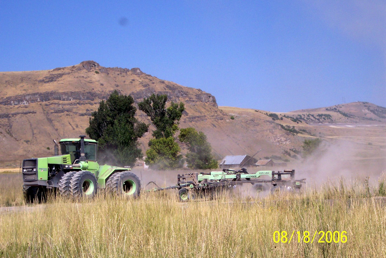 LARRY ROUNDY, FARMER, DOES WEED CONTROL WITH A VERY WIDE DISC.