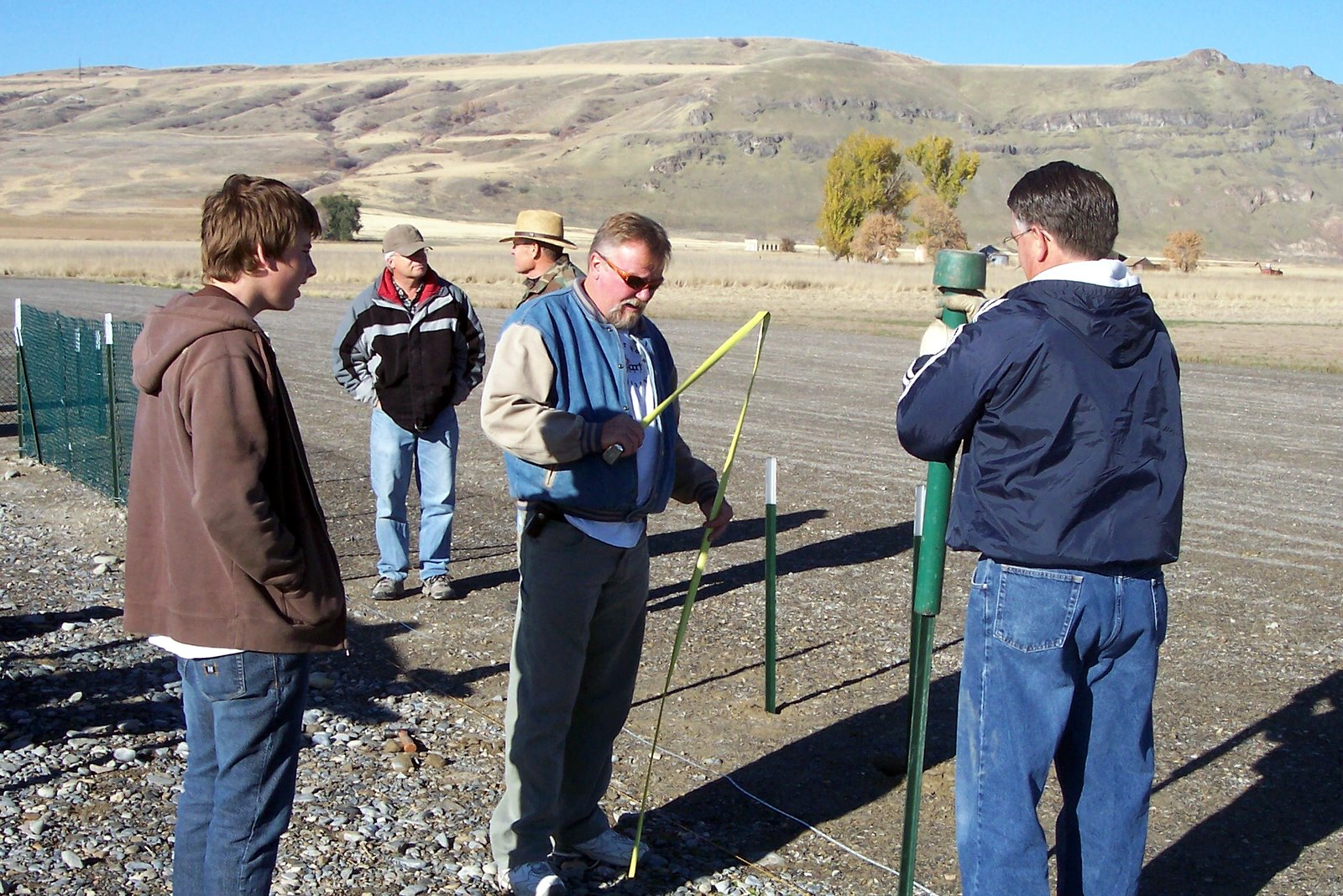 INSTALLATION OF TEMPORARY FIELD SAFETY FENCE. RICK JENSEN, DICK NELSEN, DAVE STUART, AMOS PALMER. 24 OCTOBER 2006