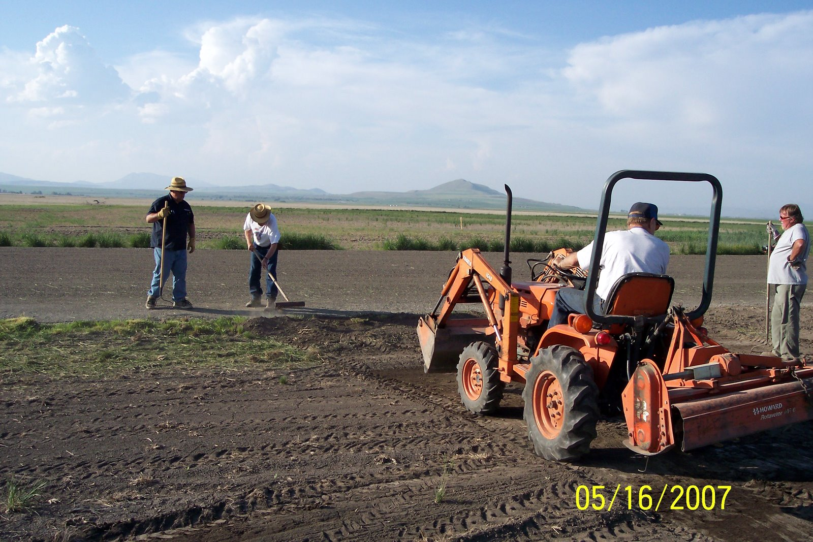BRINGING SOIL UP TO GRADE ALONG RUNWAY EDGES. DEL BULLEN ON TRACTOR WITH MICHAEL SMITH, NATE FRIEDLI AND RICK JENSEN RAKING.