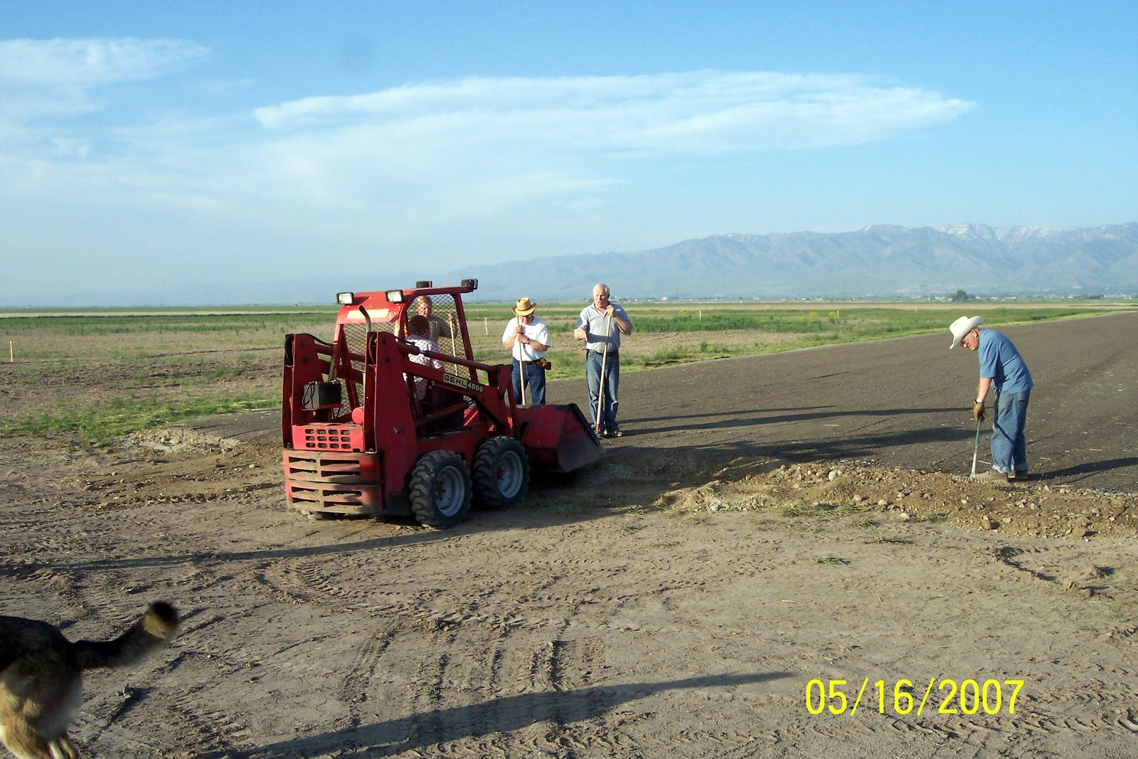 TAPERING THE WEST END OF RUNWAY. KELLY SMITH IN BOBCAT WITH NATE FRIEDLI, VERN SMITH AND WINSTON REESE DOING THE MANUAL LABOR.