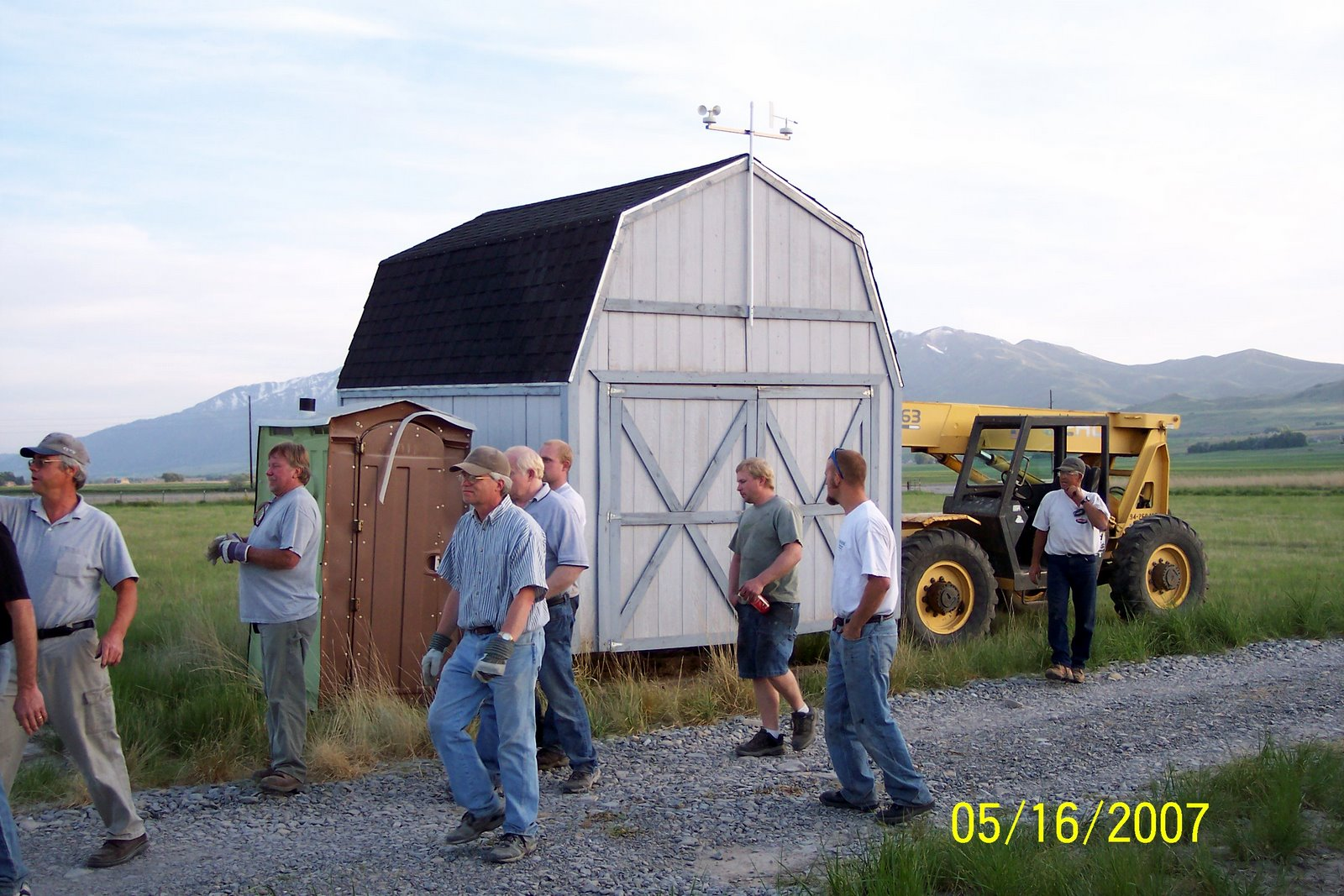 SHED IS HOISTED AND READY TO BE MOVED.