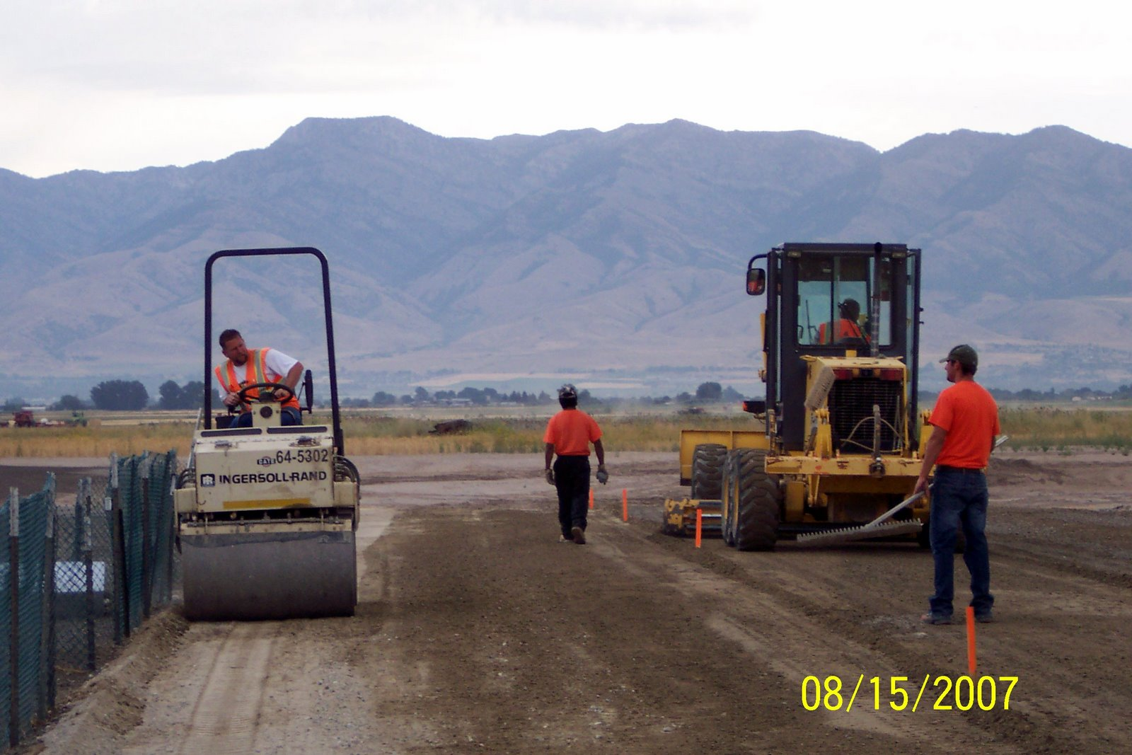 MORE ROLLING AND GRADING IN THE PITTING AREA.
