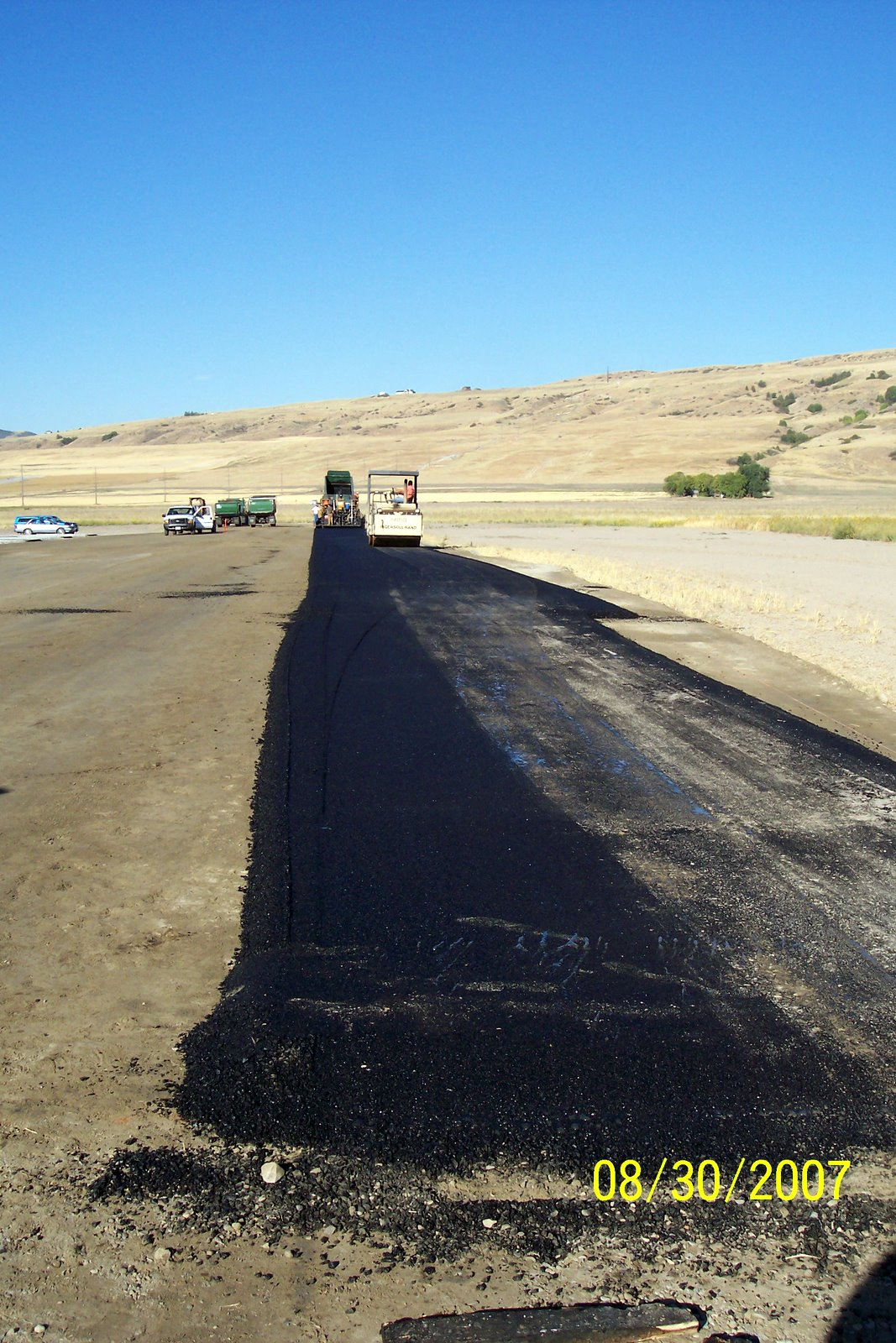 PAVING CONTINUES ALONG THE NORTH EDGE OF RUNWAY.
