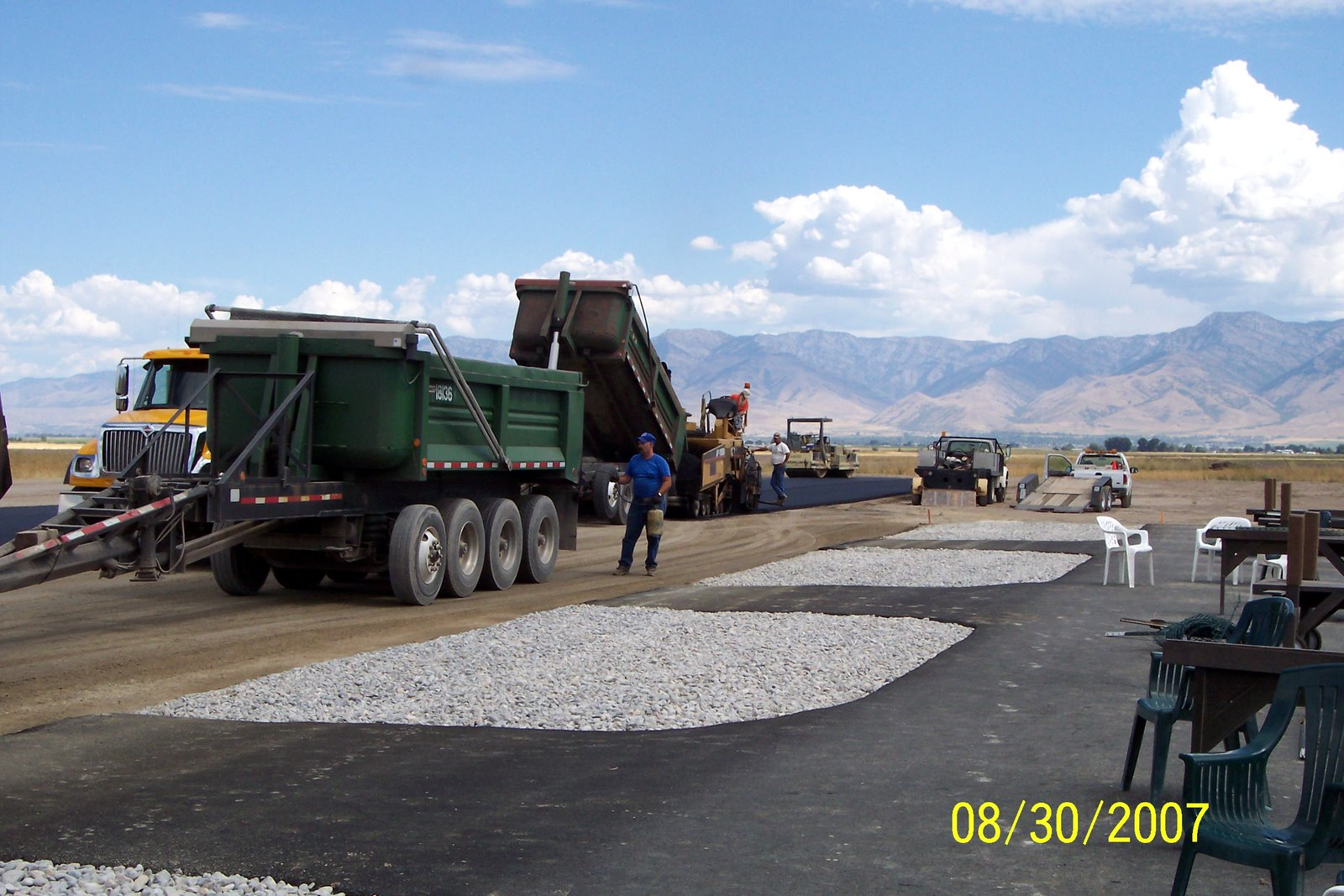 PAVING IS OVER HALF WAY COMPLETED AT THIS POINT.