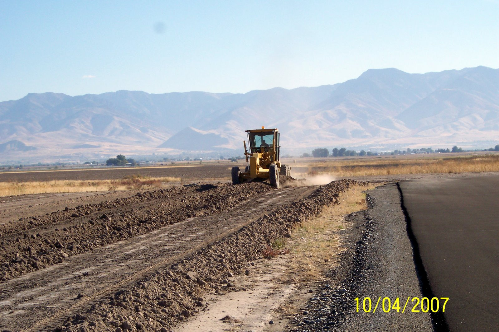 FARMER ROUNDY HELPING WITH MOVING SOIL TO HELP WITH RUNWAY TAPPER.