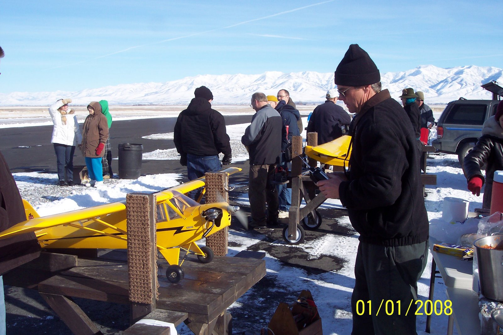 IVAN HOOLEY PRE-FLIGHT CHECK AFTER KNOCKING ICE CYCLE FROM THE CUB'S MUFFLER AT FREEZE FLY.
