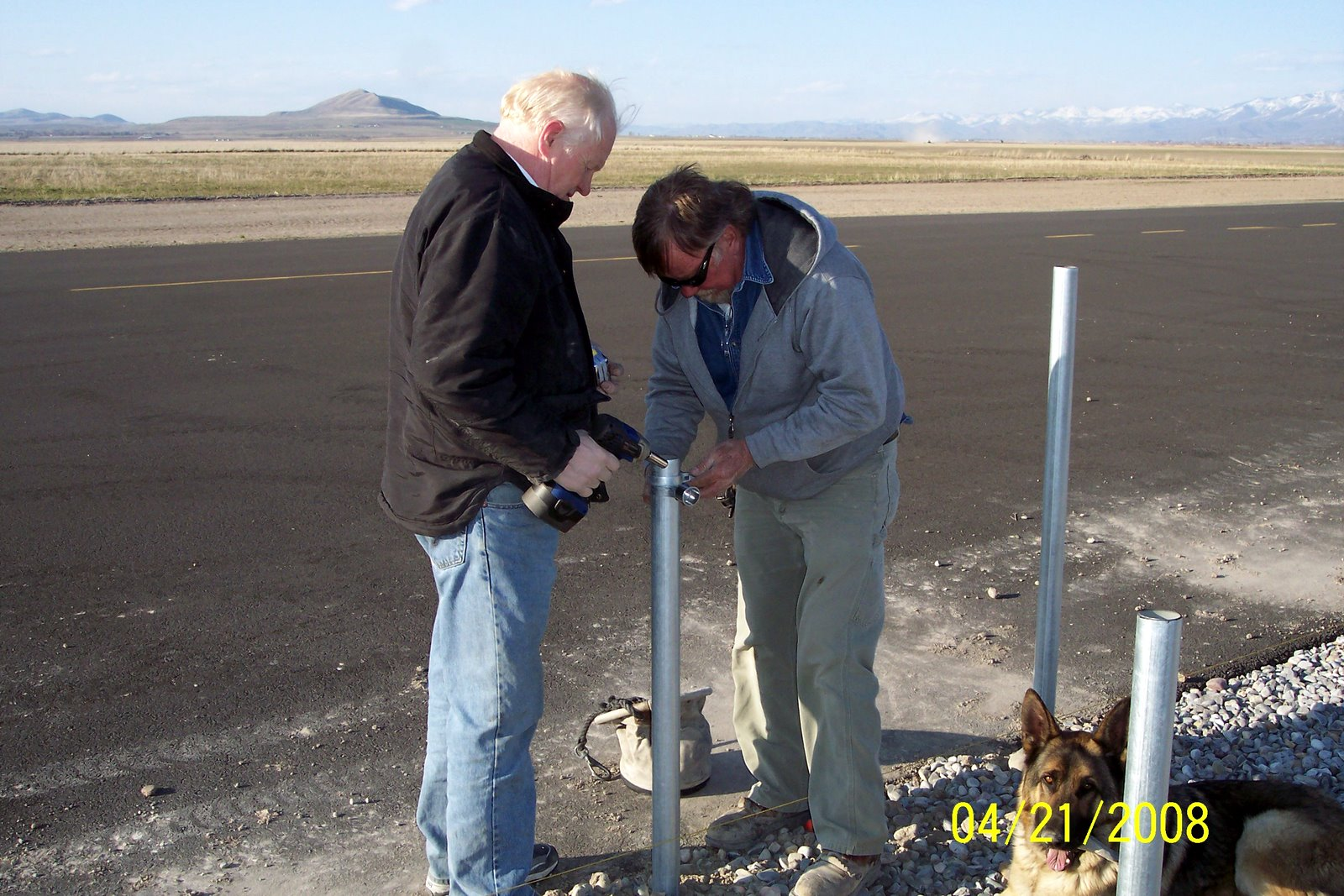 VERN SMITH AND RICK JENSEN INSTALL CLAMP FOR SAFETY FENCE.