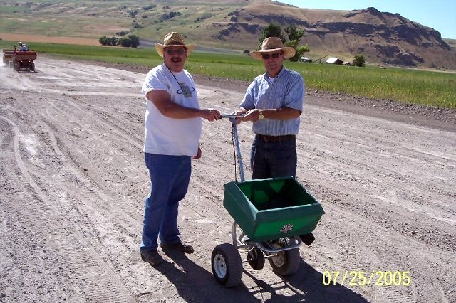 WADE FULLMER AND JERRY COKELY READY TO SPREAD SOIL STERILIZER.