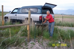RICHARD WILLIAMS STRETCHING WIRE AT S/E CORNER POST.