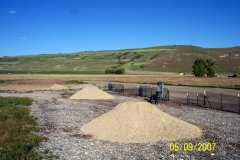 PILES OF PITTING AREA GRAVEL.
