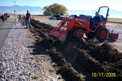 RON BLIESNER BACKFILLING DRAIN TRENCH.