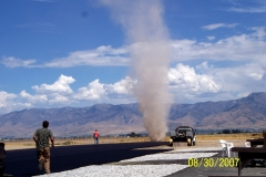 DUST DEVIL AT EAST END OF RUNWAY.